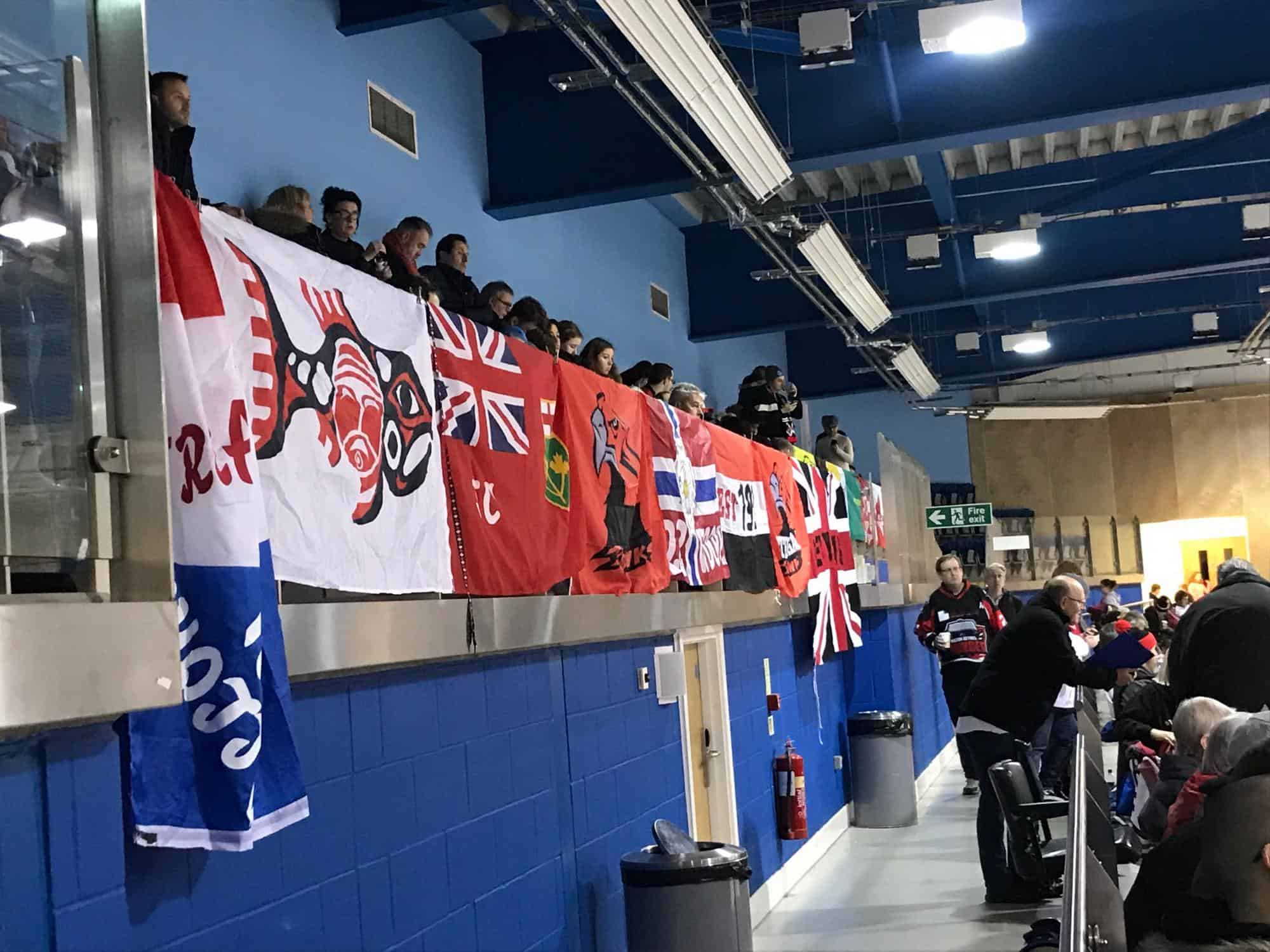 Streatham Redhawks ice hockey fans showing off their supporters flags